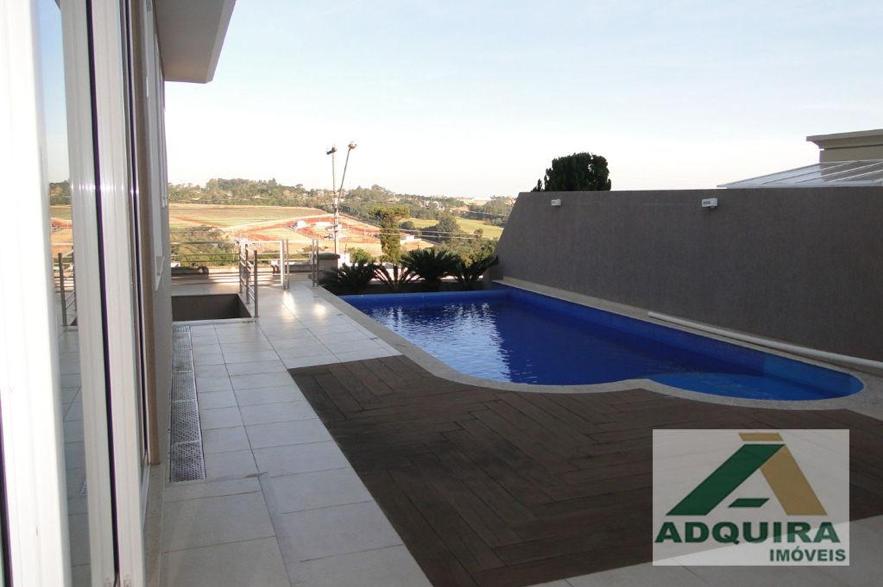 Excelente modelo de casa com piscina em Ponta Grossa com borda infinita e linda vista.
